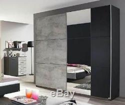 Rauch'Lenny' Sliding Door Wardrobe, Concrete & Anth. German Bedroom Furniture